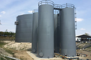repainted industrial liquid storage tanks/silos, St. Catharines ON