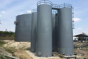 repainted industrial liquid storage tanks/silos, St. Catharines ON