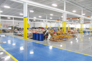 industrial painting in a Brampton plant including ceilings and epoxy floor