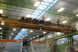 painter spray painting steel beams in a Niagara Falls factory