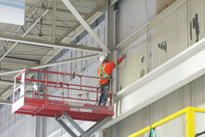 professional painter painting an industrial wall in Oshawa, ON