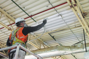 spray painting of a factory ceiling by a Mississauga painting contractor