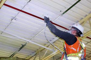 spray painting of stained metal ceiling in Burlington, Ontario