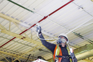 painting underway of metal ceiling by a London painting contractor