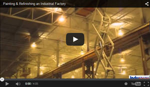 industrial spray painting a ceiling in a factory