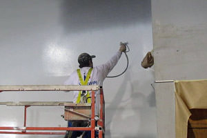 spray painting of a wall by an industrial painter in Cambridge, Ontario