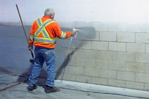 painting of a cinder block wall by an Ingersoll commercial painter