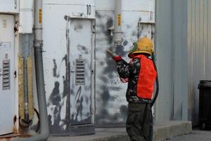 worker performing industrial sand blasting in Ajax